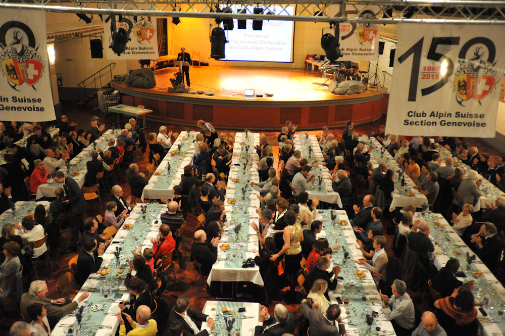 Salle communale de Plainpalais - view of diners.  Speaker is Quentin Deville, Geneva Section President. Photo by Bernard Ody