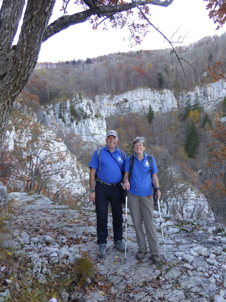 Walk on the Sunday was to the Saleve above le Coin.  Walking up through the forest to the grotte d'Orjobet over the top and down la Grande Gorge. Mike Goodyer with Pam Harris sporting ABMSAC polo shirts overlooking the gorge. Photo by Alan Norton