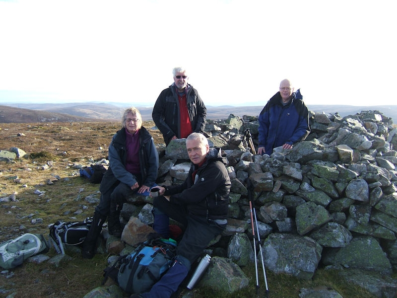 Roger James, Jim and Margaret Strachan and Philip Hands on the summit of Corryhabbie Hill. Photo by Jim Strachan
