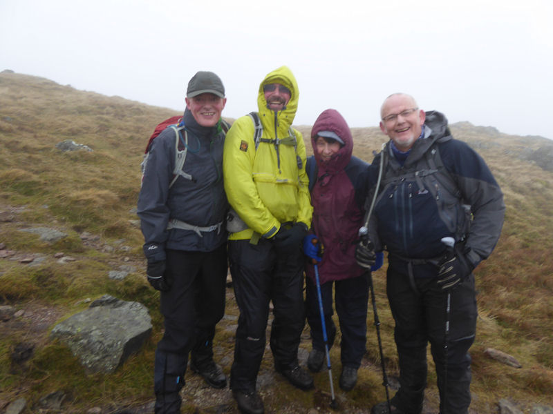 Ed, Duncan, Judy and Paul S on a windy Place Fell. Photo by Mike Goodyer
